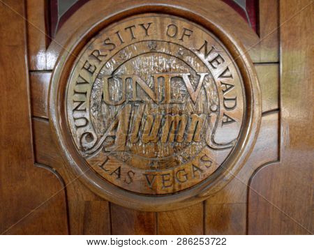 Las Vegas -  February 5, 2010:  University Of Nevada, Las Vegas Unlv Alumni Emblem On Wood Door At T
