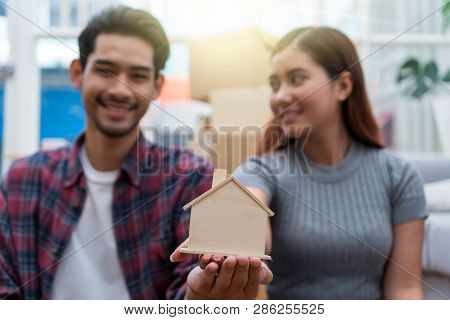Closeup Asian Young Couple Holding The House Model In Love And Glad Feeling After Successfull Packin