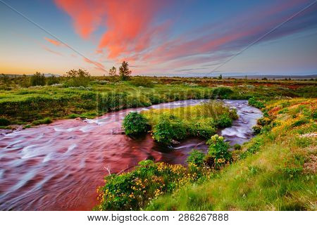 Amazing view of fresh river in morning light. Location place Geyser Park, Hvita river, Haukadalur area, Iceland, Europe. Scenic image of beautiful nature landscape. Discover the beauty of earth.