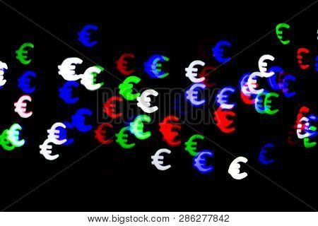 Bokeh As A Euro Sign. The Concept Of Wealth And Money, Trading On The Stock Exchange And Economic Gr