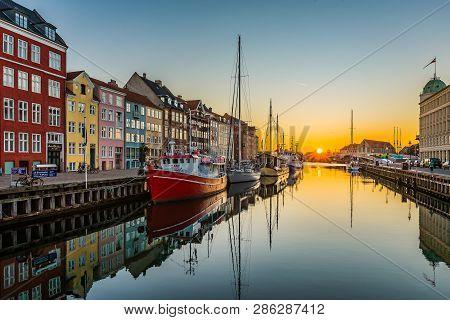 The Tranquil Water Of The Copenhagen Harbor Nyhavn An Early Morning At Sunrise, Copenhagen, February