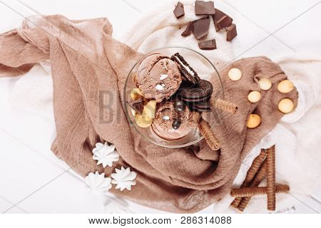 Chocolate Icecream Cookie Dessert Bowl Flat Lay. Cold Delicious Brown Ice Cream Ball And Biscuit On