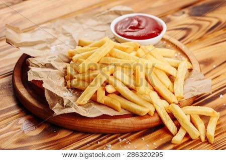 French Fry Potato Snack Food Ketchup Side View. Golden Fries Meal On Wooden Rustic Board. Fresh Fast