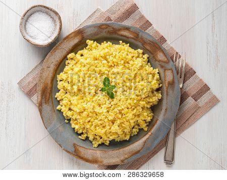 Bulgur Wheat. Boiled Bulghur Cereal In Plate On White Wooden Table. Healthy Vegetarian Food, Top Vie