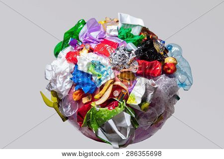 A Globe Of The Earth With Trash Over White Background, The Concept Of Ecology Problem And World Envi