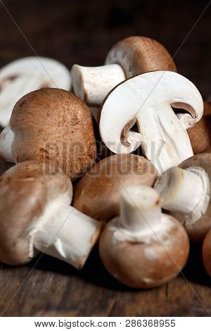 Mushrooms On A Wooden Kitchen Table, Close Up