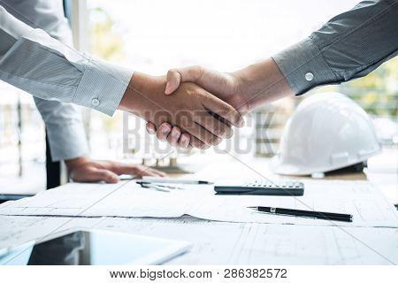 Handshake Of Collaboration, Construction Engineering Or Architect Discuss A Blueprint And Building M