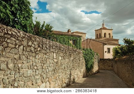 Alley With Stone Walls Going Towards Church And Steeple At Trujillo