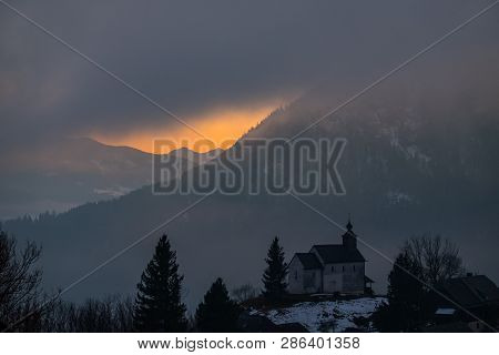 Panoramic View From Church In Village Puergg Over Valley Ennstal To Sunset Over Mountain Gumpeneck I