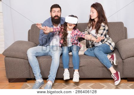 Lot of concern surrounding children using VR headsets. Daughter stuck in virtual reality. Digital world. Virtual life and dependence. Parents worry about kid in virtual reality. Virtual cyber gaming. poster
