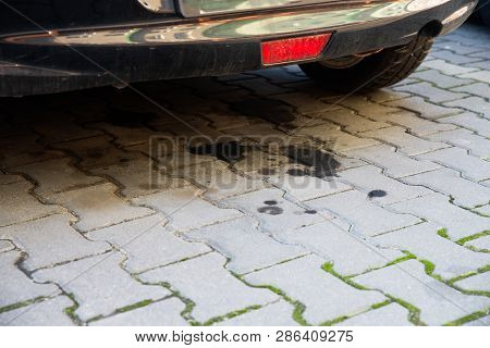 Close Up On Oil Leaking From An Old Car