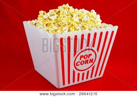 Large Bucket of Popcorn on Red