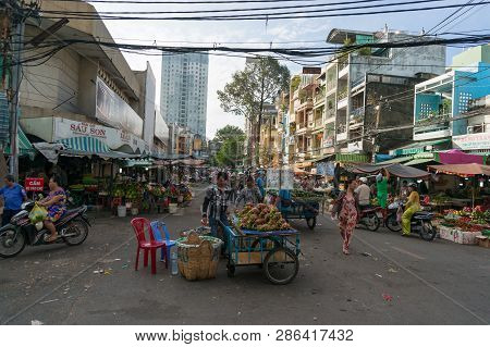 Ho Chi Minh City, Vietnam - August 25, 2017: Stall Vendors Selling Produce At Cho Xom Chieu Local Ma