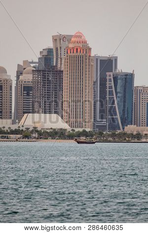 DOHA, QATAR - January 30, 2017: View across Doha Bay. to the towers in Dafna business district at sunset