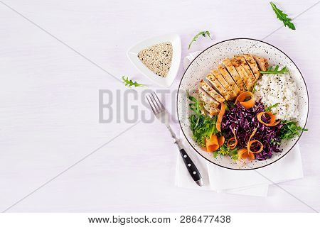 Healthy Salad. Buddha Bowl Dish With Chicken Fillet, Rice,  Red Cabbage, Carrot, Fresh Lettuce Salad