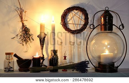 Old-fashioned lamp, pentagram, healing herbs and witchcraft objects. Magic gothic ritual. Wicca, esoteric, divination and occult background with vintage objects poster