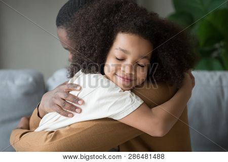 Cute Mixed Race Child Daughter Embracing Father Feeling Love Connection