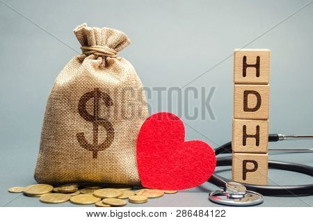 Wooden Blocks With The Word Hdhp And Money Bag With Dollar Sign. High-deductible Health Plan Concept