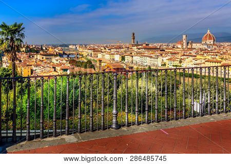 Florence, Italy Viewpoint At Piazzale Michelangelo And Defocused View Duomo Dome And Old Town