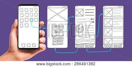 UI development. Male hand holding smartphone with wireframed user interface screen prototypes of a mobile application on ultra violet background.
