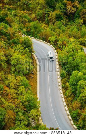Tourism Vacation And Travel. Camper Van On Road In Rocky Autumn Mountains Meteora Greece
