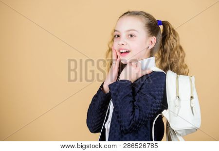 Popular useful fashion accessory. Schoolgirl ponytails hairstyle with small backpack. Carrying things in backpack. Learn how fit backpack correctly. Girl little fashionable cutie carry backpack poster