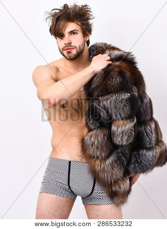 Bachelor Rich Lover. Guy Attractive Posing Fur Coat On Naked Body. Luxury Lifestyle And Wellbeing. L