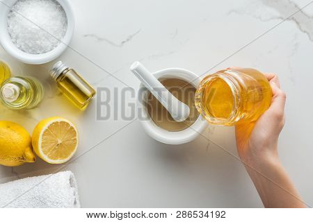 Cropped View Of Woman Pouring Honey Into Pounder, And Various Natural Ingredients For Handmade Cosme