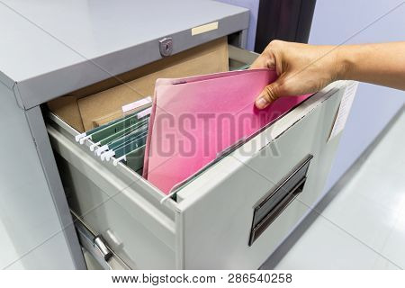 Close Up Hand Of Man Search Files Document In A File Cabinet In Work Office, Concept Business Office