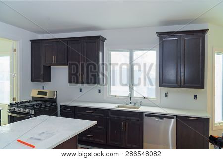 Home Improvement Kitchen Remodel Design Construction Of A Kitchen With Maple Granite Counter In Home
