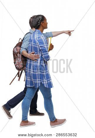 Side view of interracial going couple who points somewhere. Two students go to the lecture. Rear view people collection. Isolated over white background. A young student shows the way to black student poster