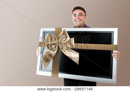 Man Holding Lcd Tv