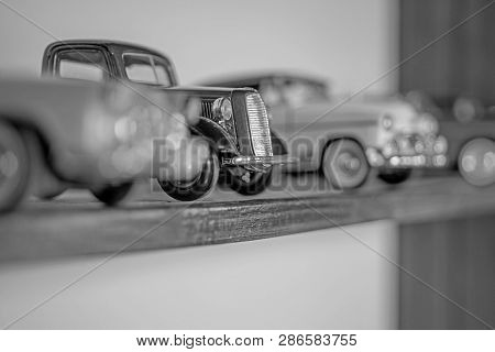 Vintage Inspired. Retro Car Models On Shelf. Retro Styled Cars. Toy Cars With Retro Design. Classic