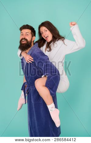Couple In Bathrobes Having Fun Turquoise Background. Lets Stay At Home And Have Fun. They Always Hav