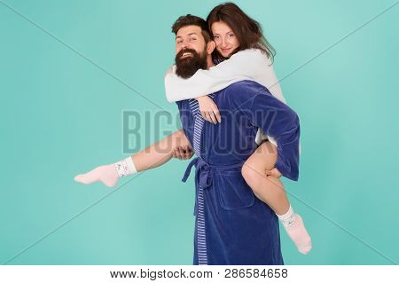 Lets Stay At Home And Have Fun. Couple In Bathrobes Having Fun Turquoise Background. They Always Hav