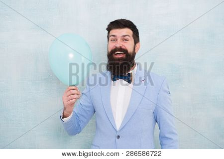 Lets Have Fun. Man Groom Blue Tuxedo Bow Tie Hold Air Balloon. Wedding Fun. Groom Bearded Hipster Ha