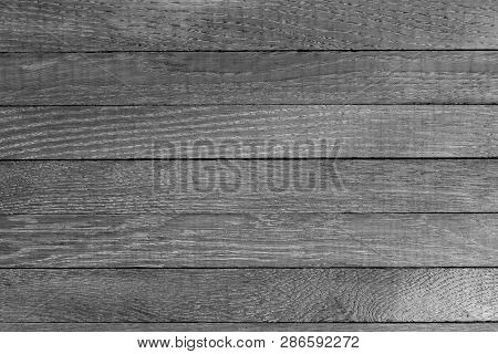 Horizontal Grayscale Wooden Table Background. Top View. Copy Space.