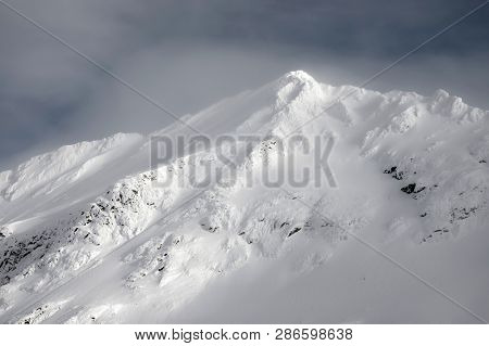Beautiful snow-capped mountains in the Transylvanian Alps, Romania. Alpine landscape in the mountains