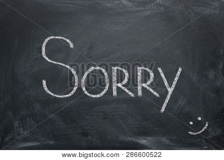 Sorry - Inscription In Chalk On A Blackboard. Apologize Concept.