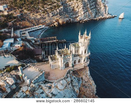Swallow Nest Aerial Drone Shot, Ancient Castle On Top Of Mountain Cliff Near Sea Yalta Region, Crime