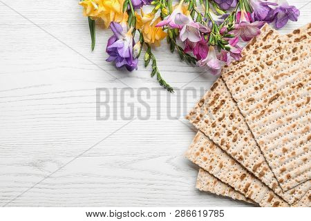Flat Lay Composition Of Matzo And Flowers On Wooden Background, Space For Text. Passover (pesach) Se