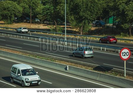 Sunlight Over Cars In A Multi Lane Highway With Heavy Traffic At Business District Near The Barajas