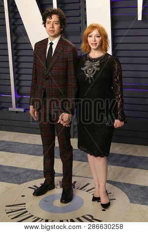 LOS ANGELES - FEB 24:  Geoffrey Arend, Christina Hendricks at the 2019 Vanity Fair Oscar Party on the Wallis Annenberg Center for the Performing Arts on February 24, 2019 in Beverly Hills,