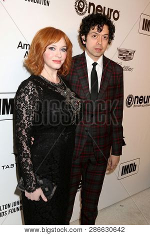 LOS ANGELES - FEB 24:  Christina Hendricks, Geoffrey Arend at the Elton John Oscar Viewing Party on the West Hollywood Park on February 24, 2019 in West Hollywood, CA