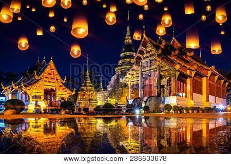 Yee Peng Festival And Sky Lanterns At Wat Phra Singh Temple At Night In Chiang Mai, Thailand.