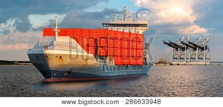 Container Ship At Sea Carrying Containers With The Flag Of China