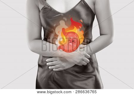 The Photo Of Cartoon Stomach On Woman's Body Against A Gray Background, Gastroesophageal Reflux Dise