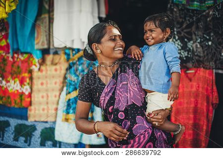 India, Goa, The Village Of Benaulim  - November 15, 2012: Unidentified Indian Woman And Baby In Her