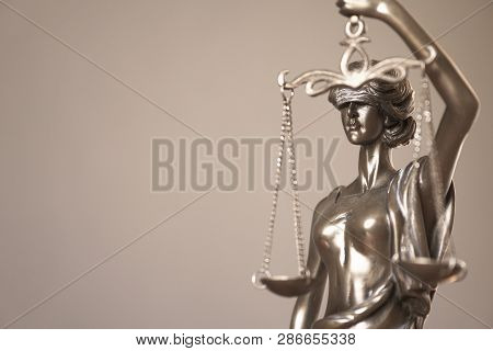 Lady Justice Or Justitia - Detail Of Blind Or Blindfolded Bronze Statue Holding Balance Scales - Law