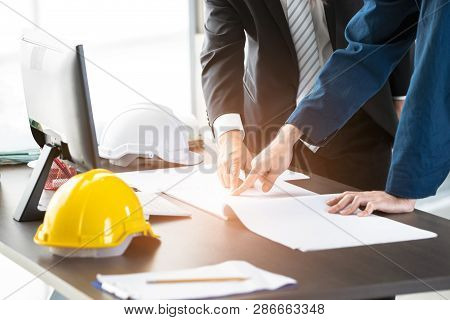 Engineers Discuss About Blueprint In Modern Office, Concept For Discuss About Blueprint In Modern Of